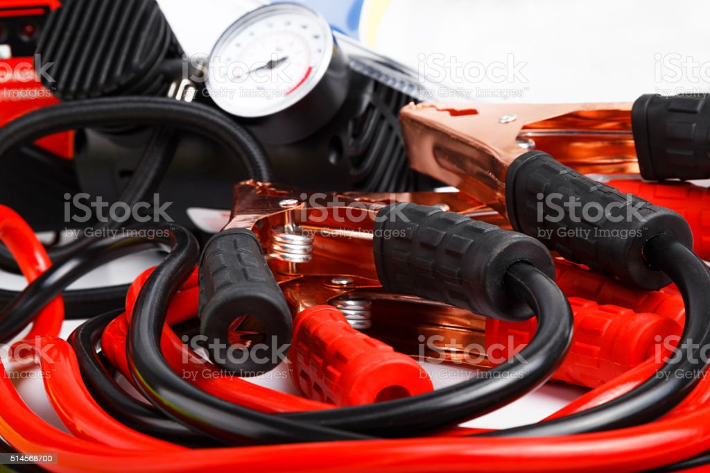 Starter cables and a pressure gauge for a car stock photo