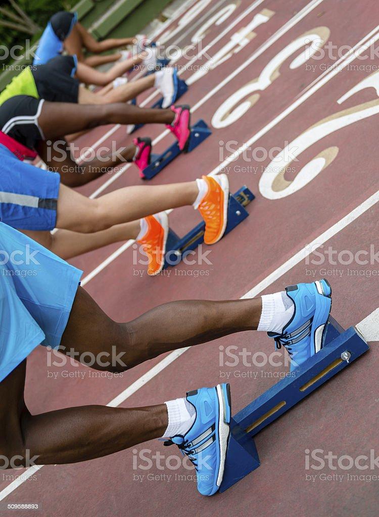 Starting block of athletes stock photo