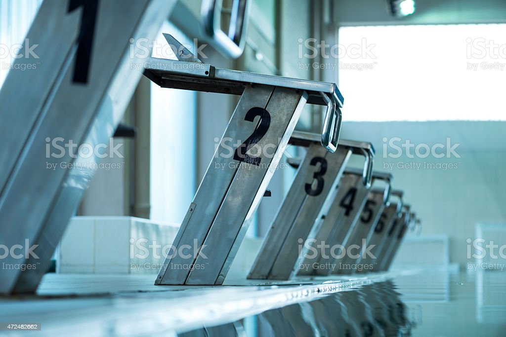 Starting blocks in a row stock photo