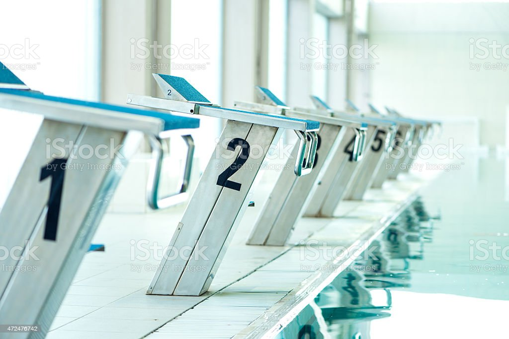 Starting blocks in a swimming pool stock photo