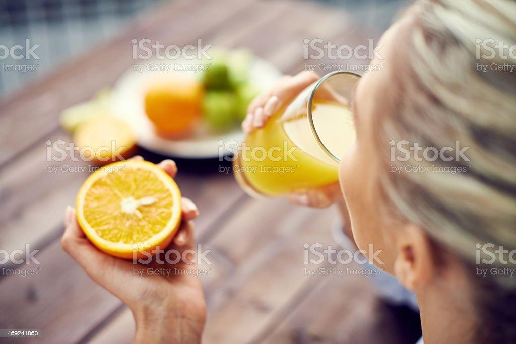 Starting day with orange juice stock photo