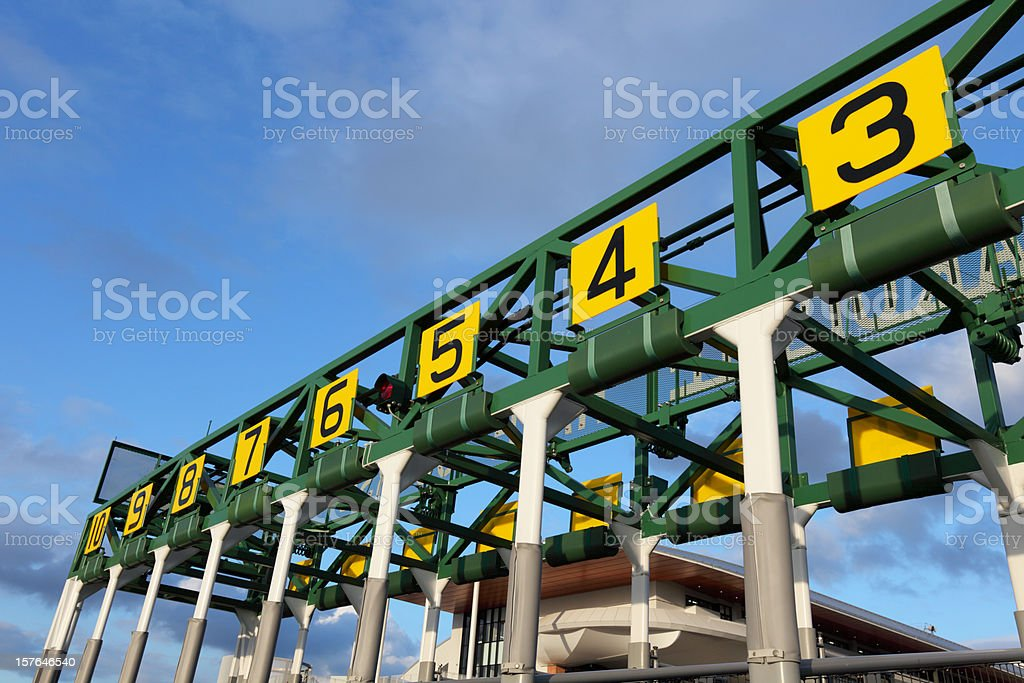 Starting gate that has number in yellow boards stock photo