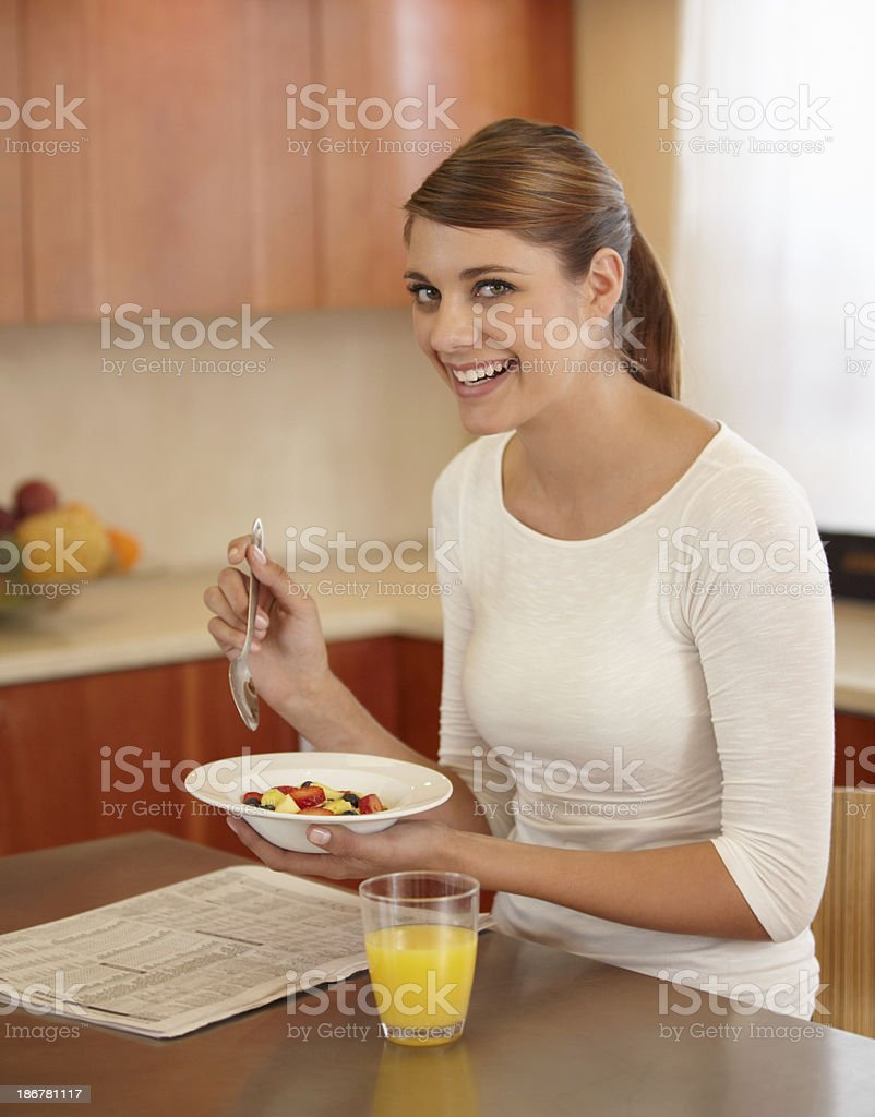 Starting her day with a fruit salad for breakfast royalty-free stock photo