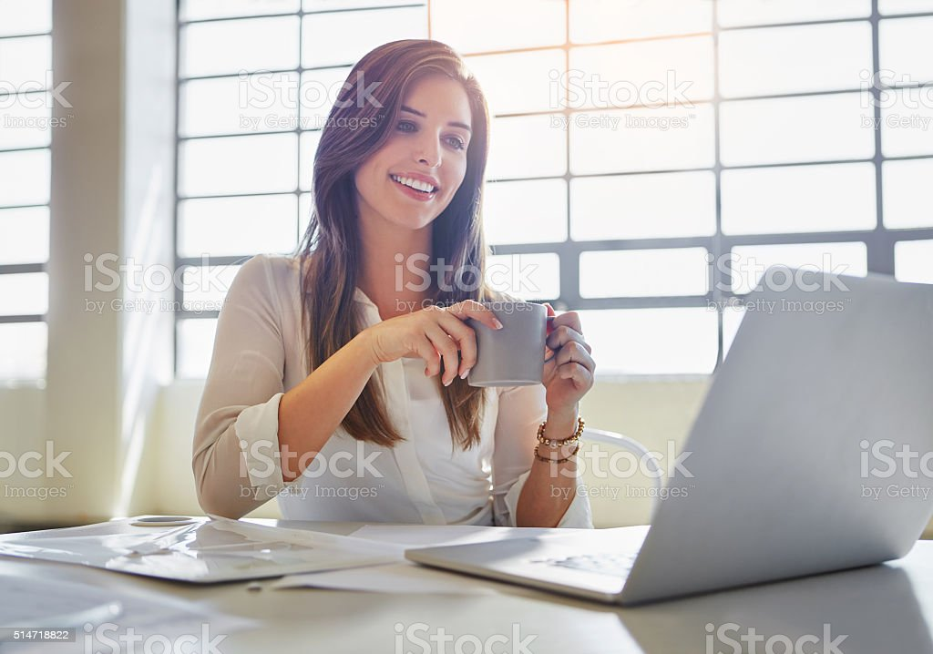 Starting her workday with an inspiring email stock photo