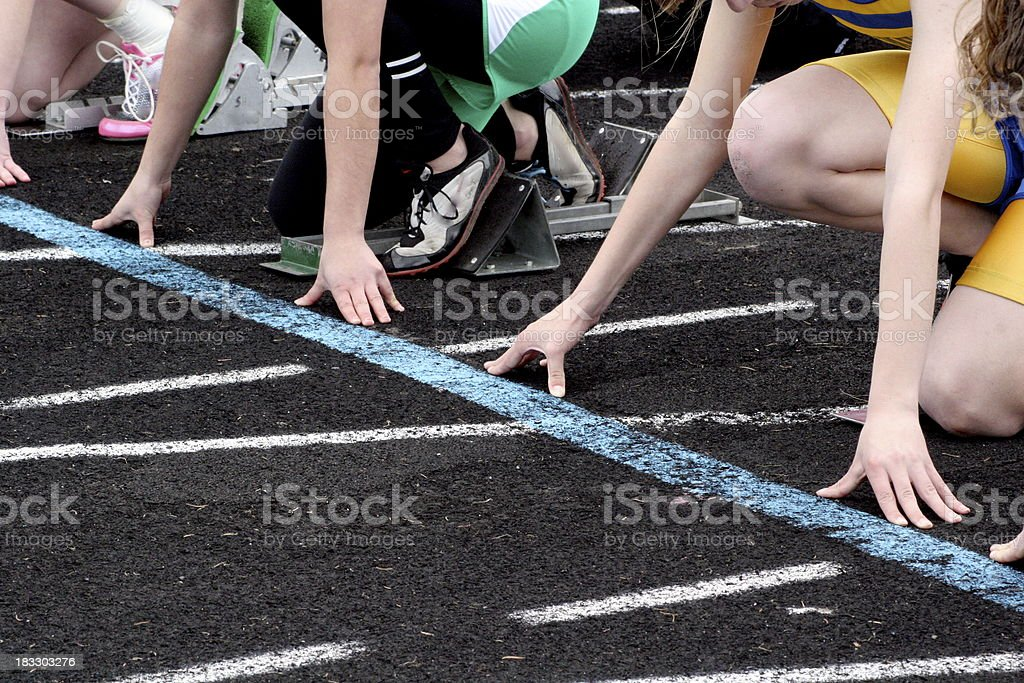Starting line at girl's track meet royalty-free stock photo