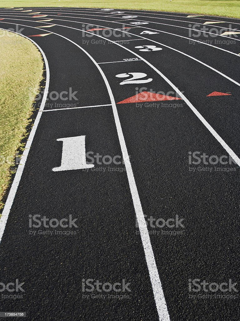 Starting line of a racetrack divided and numbered in white royalty-free stock photo