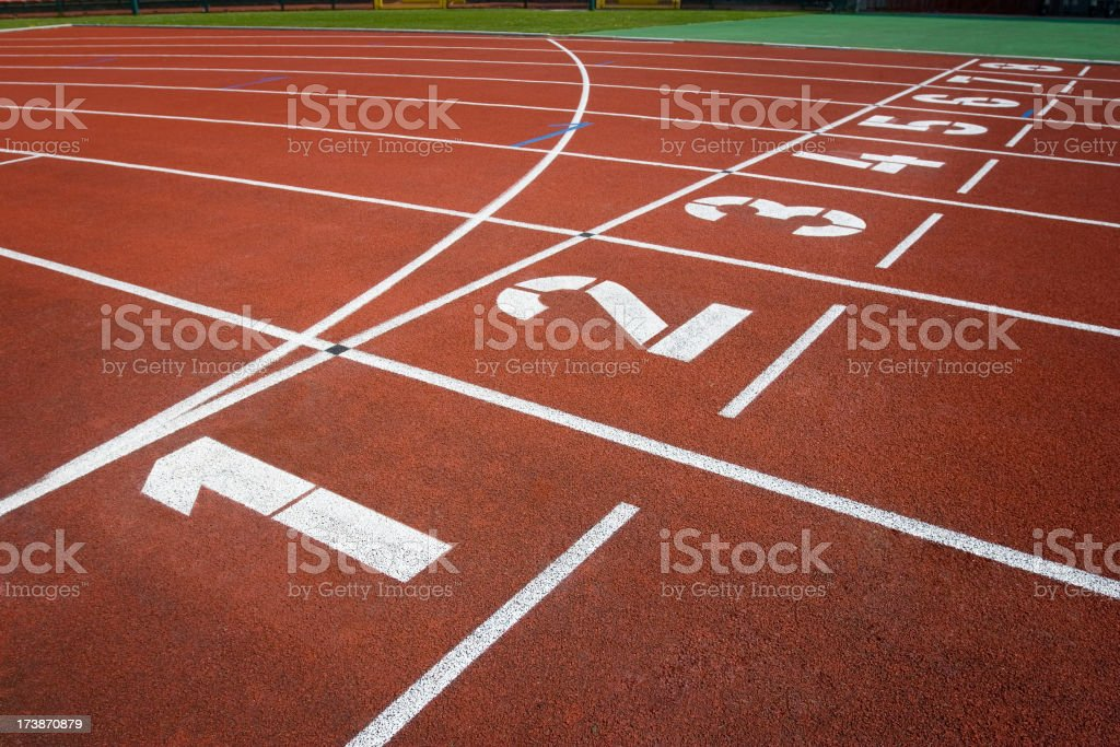 Starting Line of Track Running Lanes in Sports Arena. stock photo