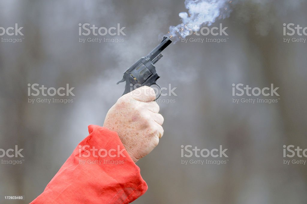 Starting pistol being fired. stock photo