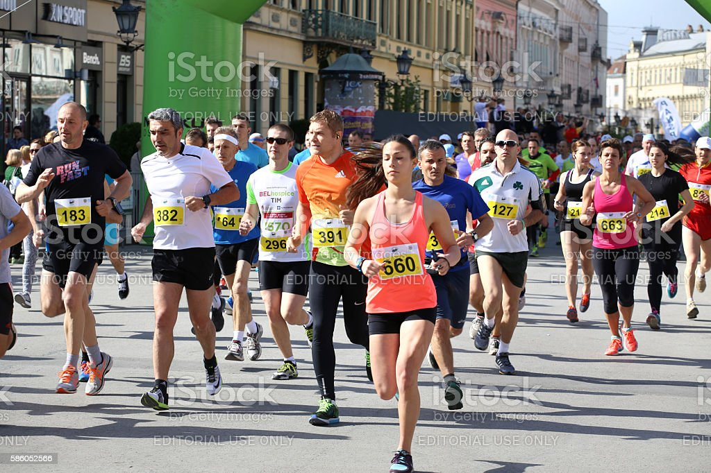 NOVI SAD, SERBIA - APRIL 03: Starting runners, participants stock photo