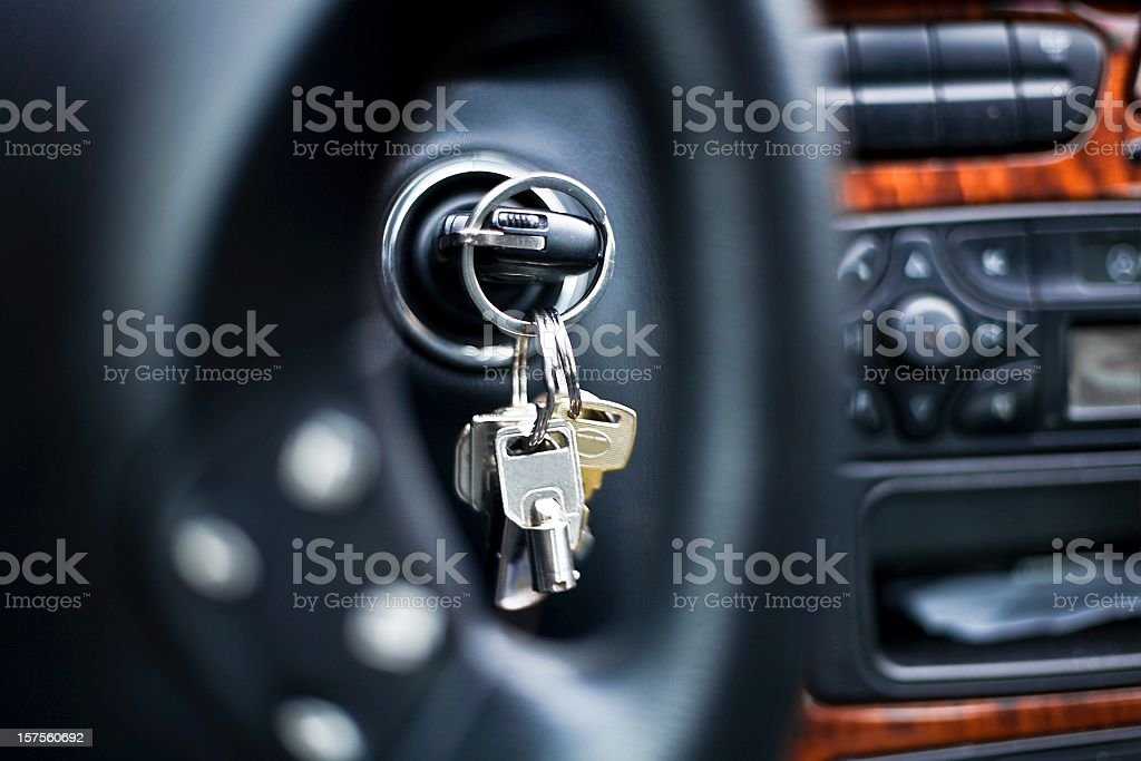 starting the car - car key in ignition lock stock photo