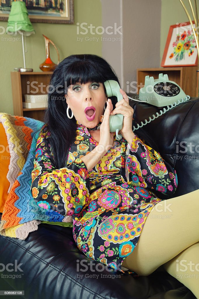 Startled Female Covering Phone stock photo