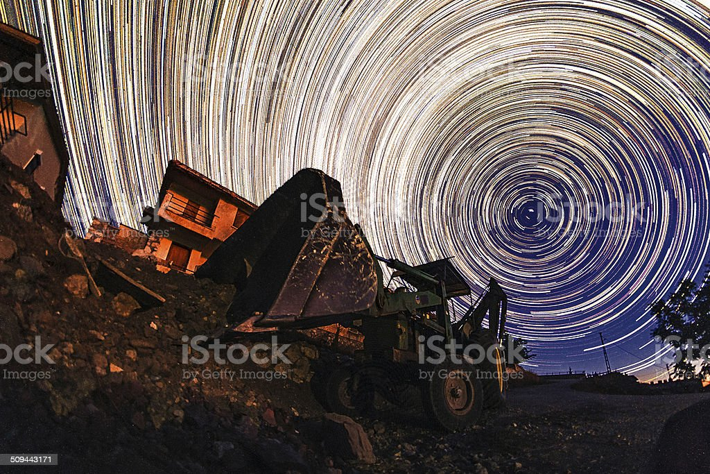 Startrails and the bulldozer royalty-free stock photo