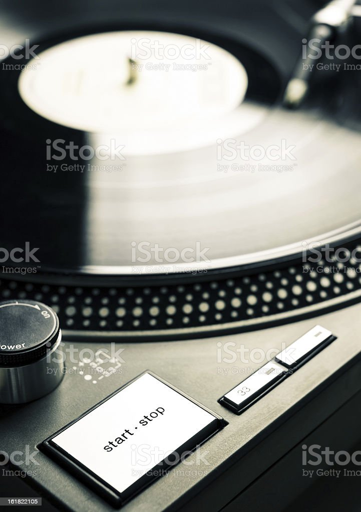 Start-stop button of old fashioned turntable royalty-free stock photo