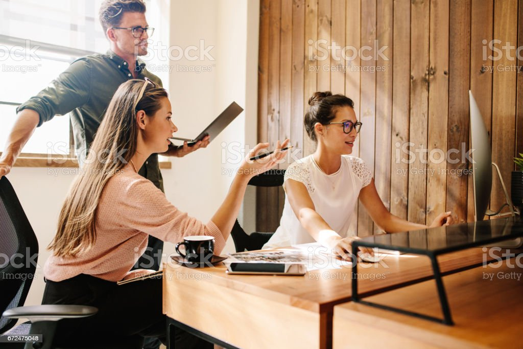 Startup business team working on computer stock photo