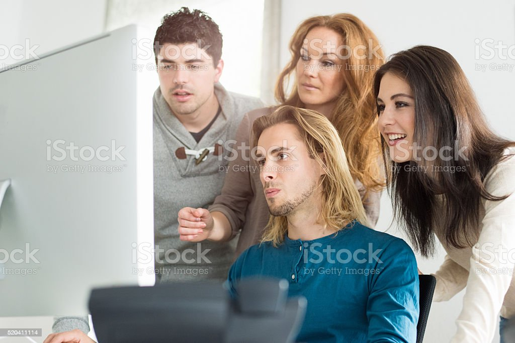 Startup company team checking new website stock photo