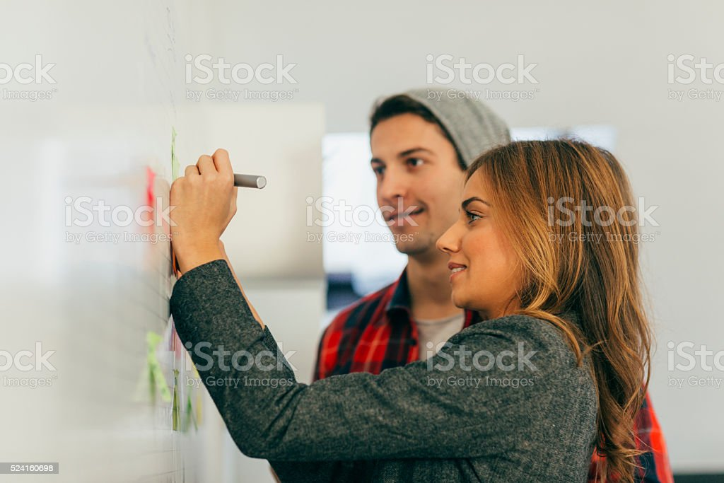 Start-up Coworkers Standing and Brainstorming. stock photo