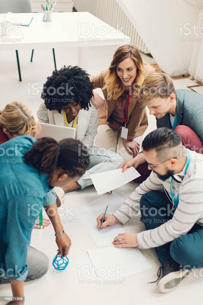 Startup Team Brainstorming On The Floor. stock photo