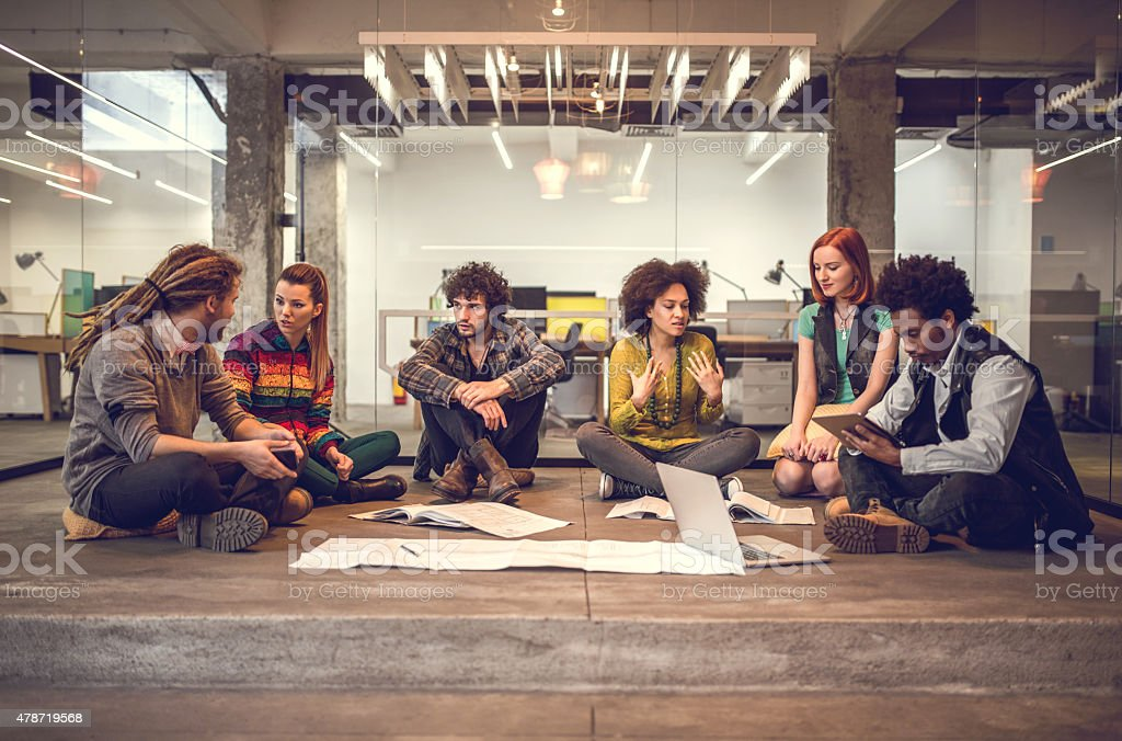 Start-up team communicating and planning on a meeting in office. stock photo
