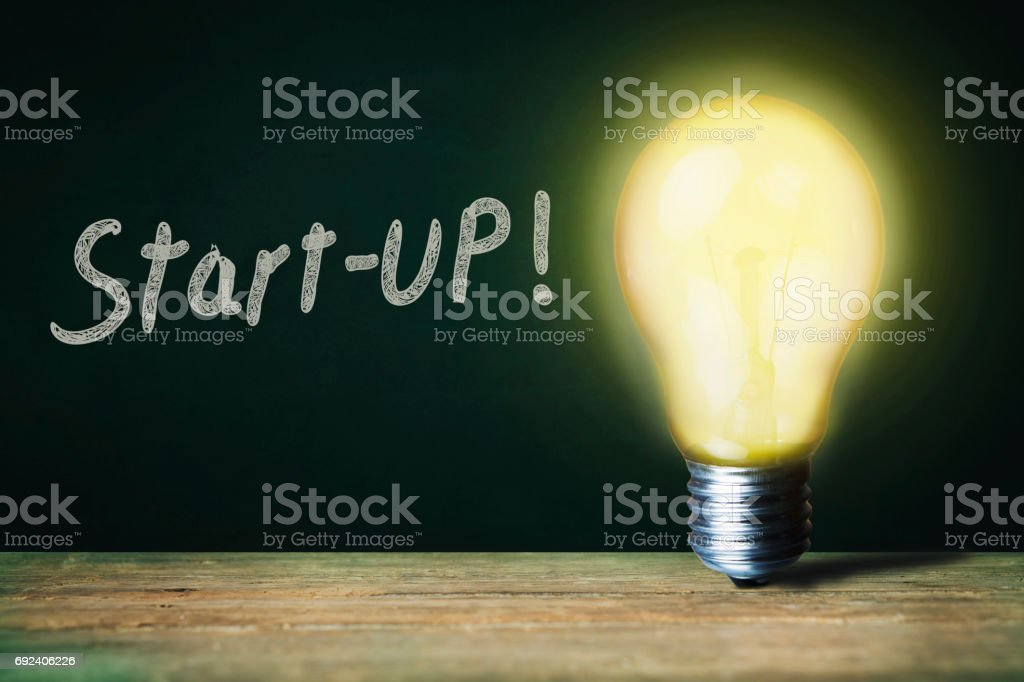 Start-up text and  bulb stock photo