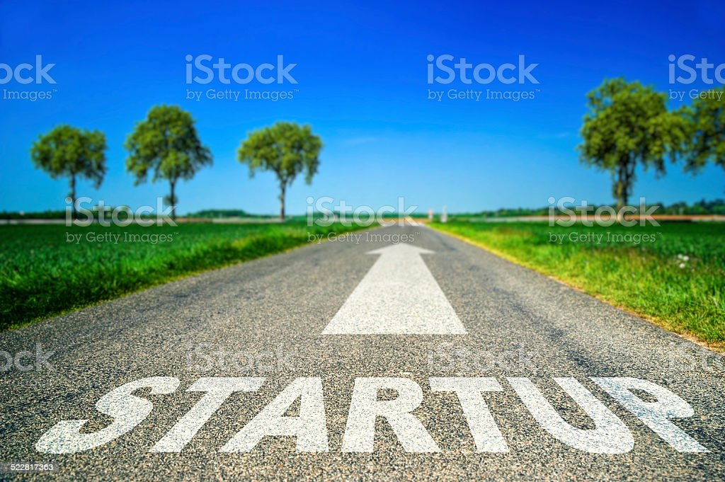 Startup word painted on asphalt road royalty-free stock photo