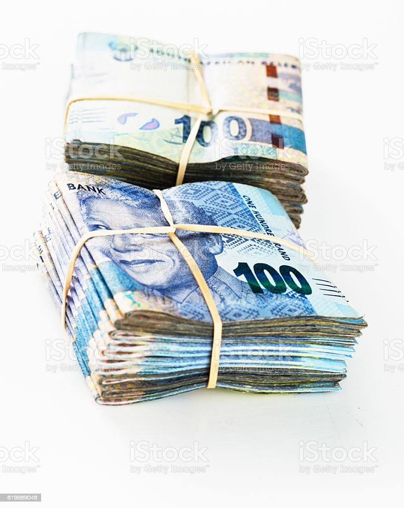 Stash of South African ready cash: bundled R100 banknotes stock photo