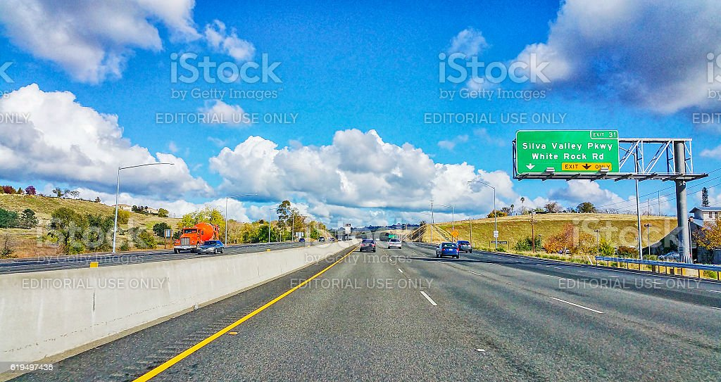 State Highway with great clouds and Cell Phone stock photo