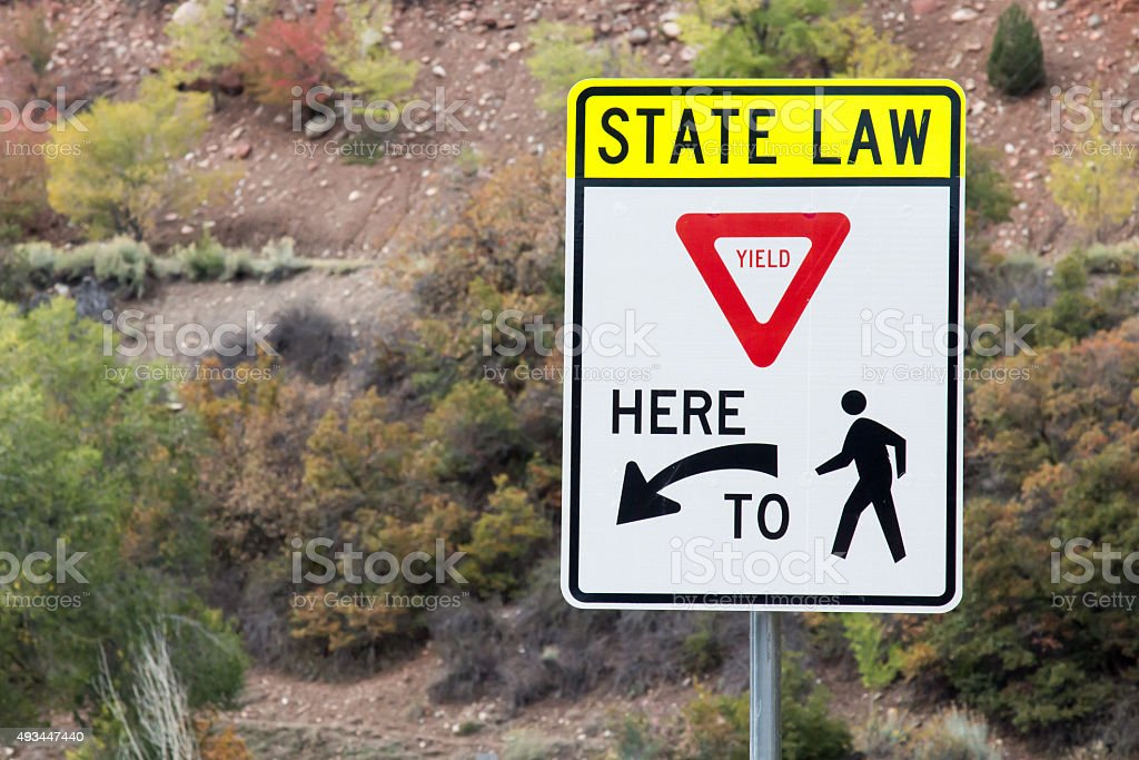 State Law - Yield Here to Pedestrians stock photo