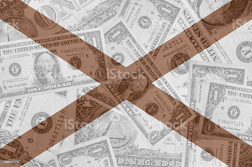 US state of alabama flag with transparent dollar banknotes stock photo