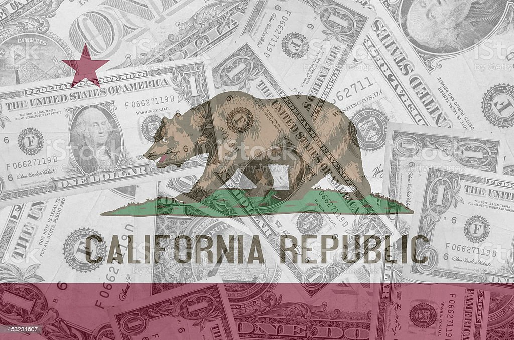 US state of california flag with transparent dollar banknotes stock photo