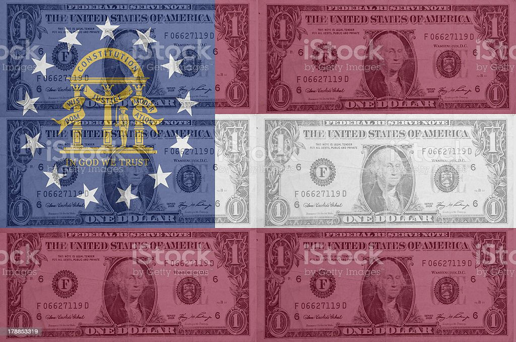 US state of georgia flag with transparent dollar banknotes stock photo