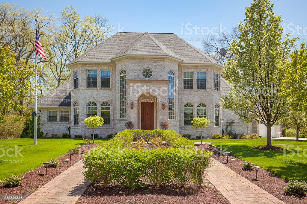 Stately mansion home with landscaped front yard. stock photo