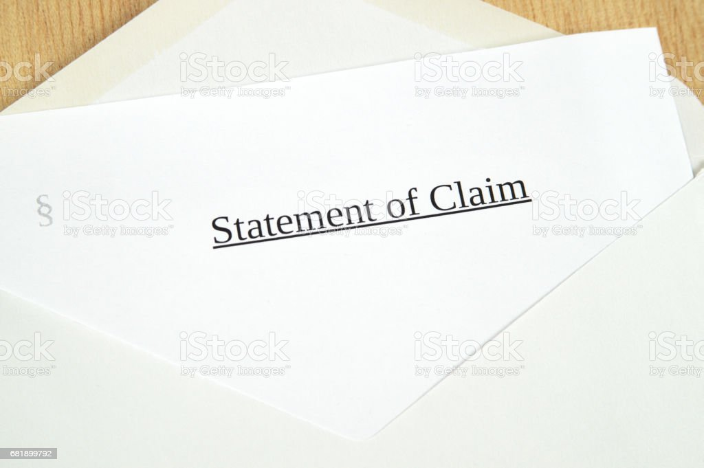 Statement of Claim printed on white paper and envelope, wooden background stock photo