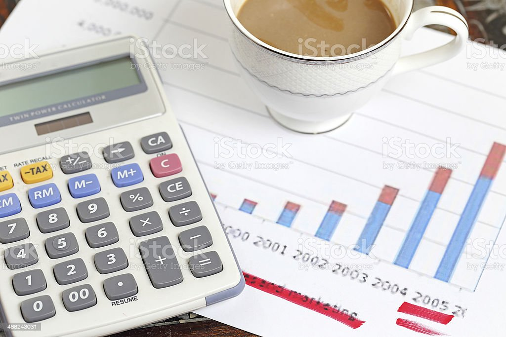statement with calculator and coffee royalty-free stock photo