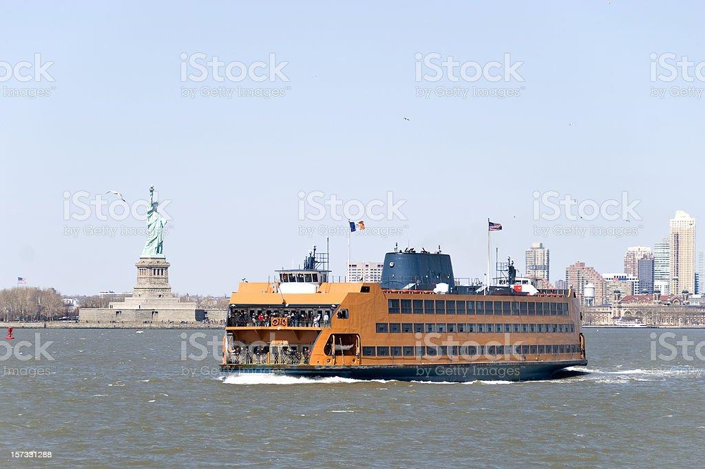 Staten Island ferry and Statue of Liberty stock photo