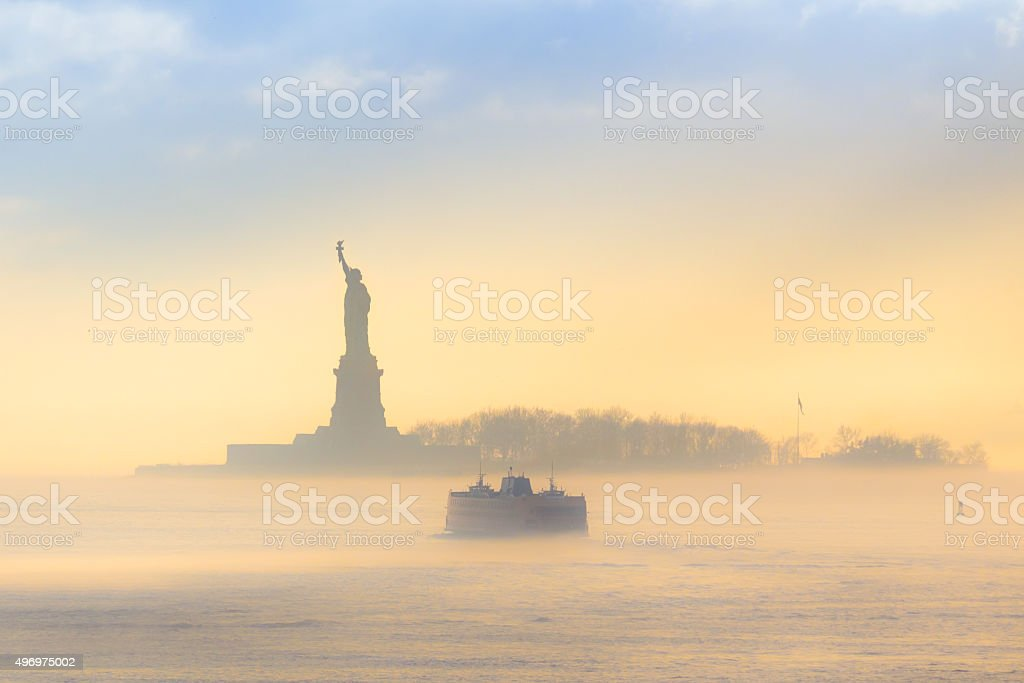 Staten Island Ferry cruises past Statue of Liberty. stock photo