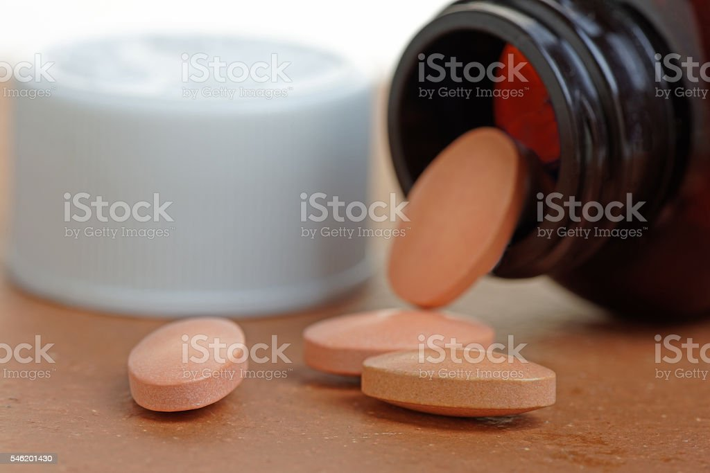 Statins or Generic Tablets  in Close Up with Bottle stock photo