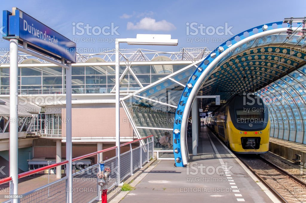 Station Duivendrecht in Amsterdam with Dutch intercity train stock photo