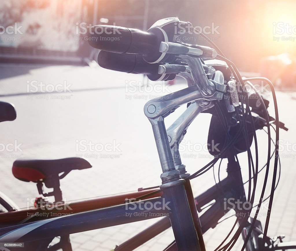 Station of urban bicycles for rent downtown stock photo