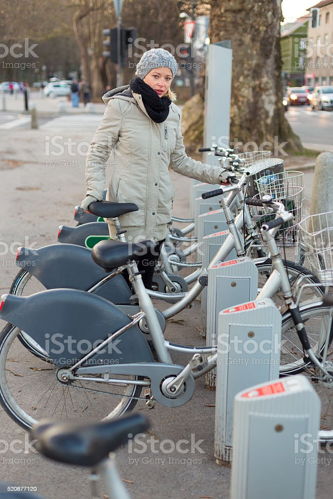 Station of urban bicycles for rent. stock photo