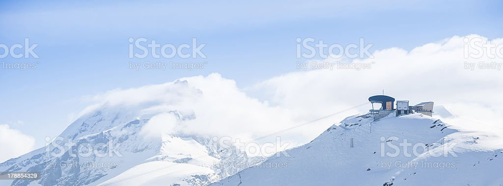 Station with Snow Mountain View royalty-free stock photo