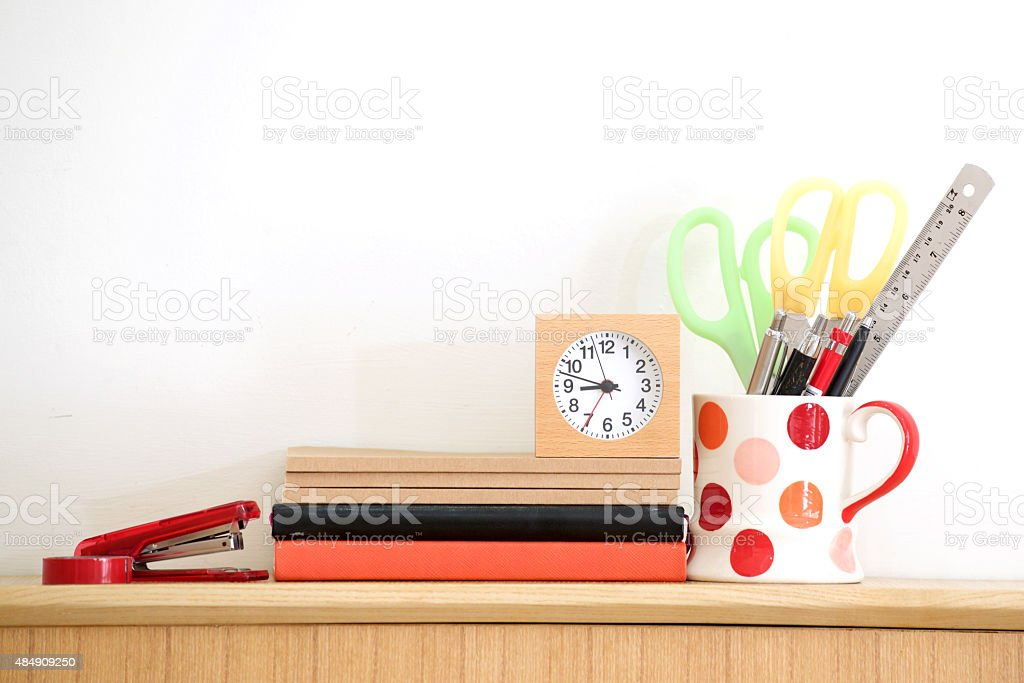 Stationary at home office, white wall background stock photo