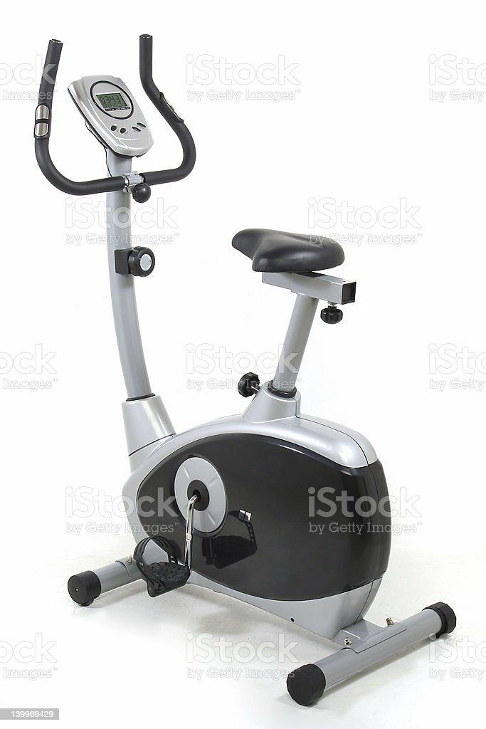 Stationary bike. Gym machine royalty-free stock photo