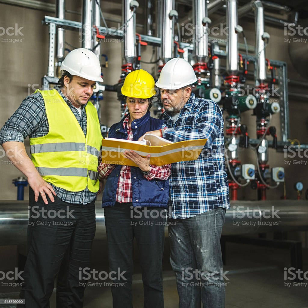 stationary engeneers at work stock photo