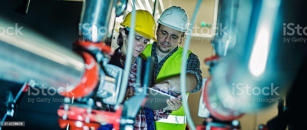 stationary engeneers at work stock photo