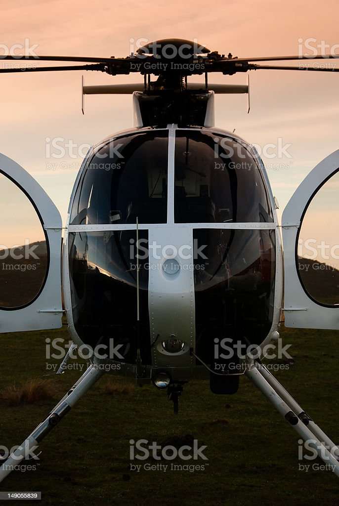 Stationary helicopter at dawn stock photo