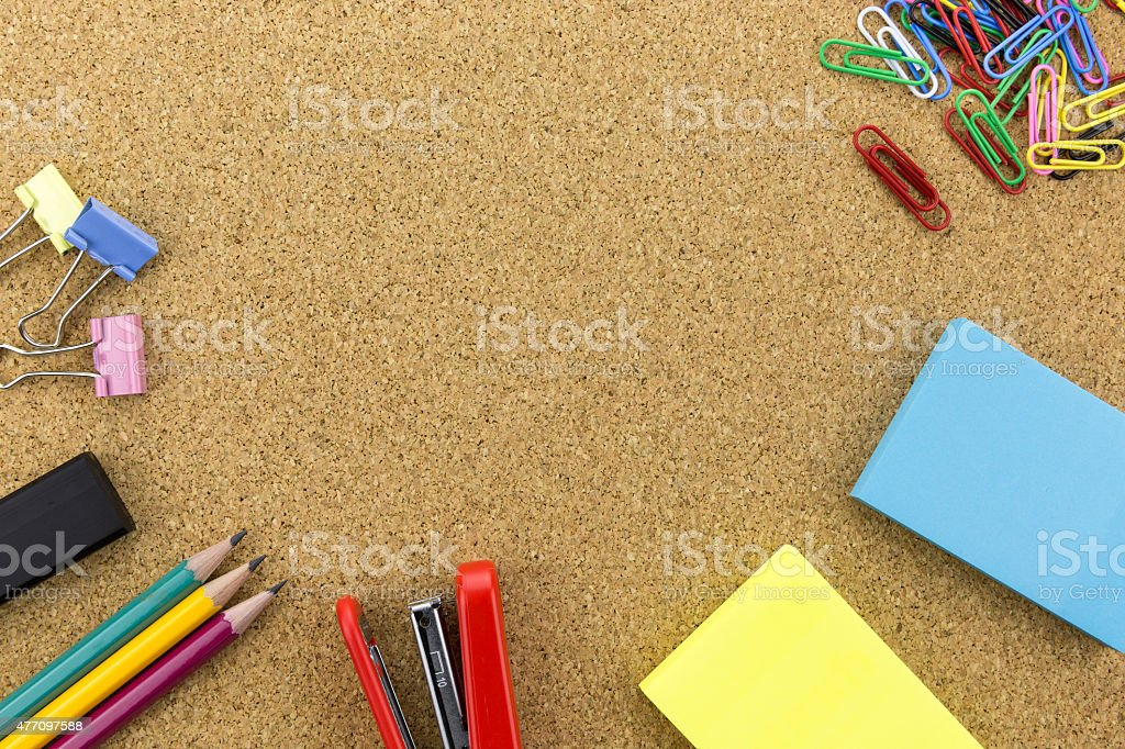 Stationary on cork board stock photo