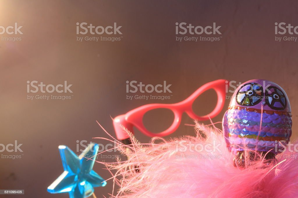Stationary set with owl, glasses, pink feathers and a star stock photo