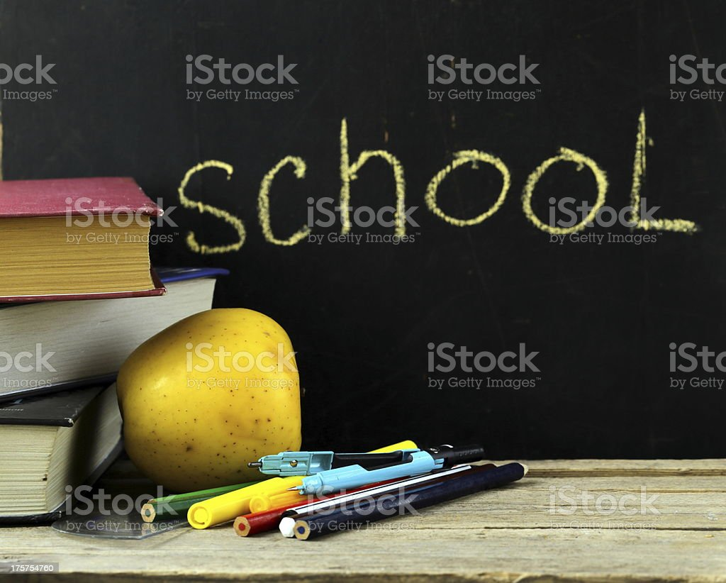 stationery (pen, pencil, ruler, compass) and a book royalty-free stock photo