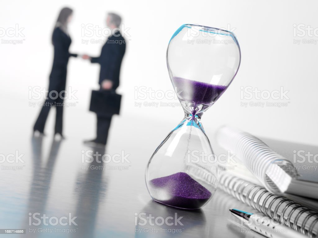 Stationery and Hourglass in the Office royalty-free stock photo