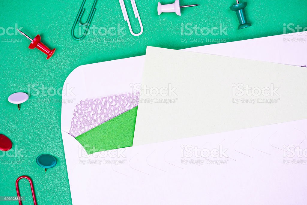 Stationery background with envelope and pins stock photo